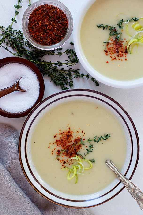 Two bowls of creamy potato soup made in instant pot. This soup recipe is very simple and easy.