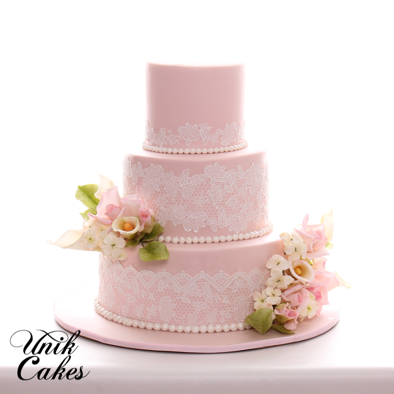 Unik Cakes   Wedding   Speciality Cakes  Pastry Shop Blush pink wedding cake with lace and roses