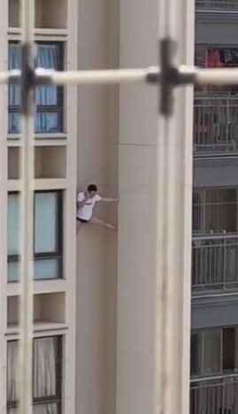 Guy Filmed Climbing Down Tower Block In Mysterious Escape
