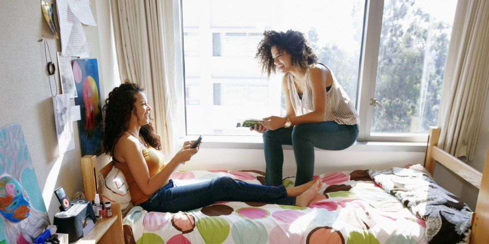 Mixed-race-college-students-relaxing-in-dorm