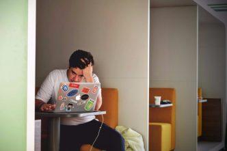 man frustrated terrible web design
