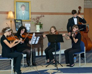 Vivace Strings Performs at USO Opening Concert