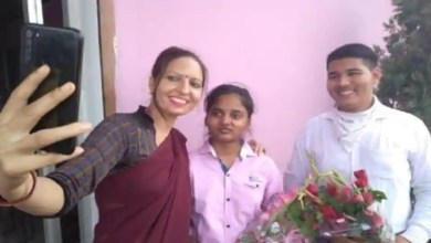 A teacher taking selfie with UP Board toppers Riya and Anurag.