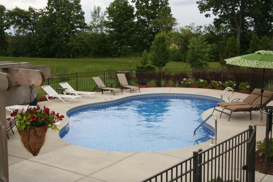 summer pool in wisconsin backyard