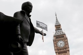 Photograph of David Lloyd George statue in Parliament Square holding 'Tories Out' placard, Big Ben in background.