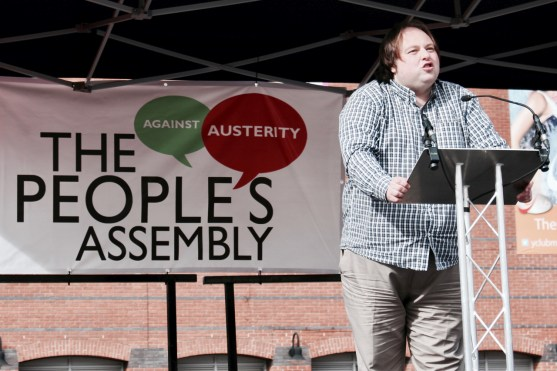 Photograph of Will Paterson (Green Party, Greater Manchester) addressing NO MORE AUSTERITY demonstrators at Castle Arena, Manchester.
