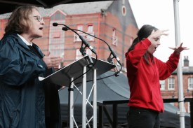 Photograph Lindsey German (National Convenor, Stop the War Coalition) of addressing NO MORE AUSTERITY demonstrators at Castle Arena, Manchester.
