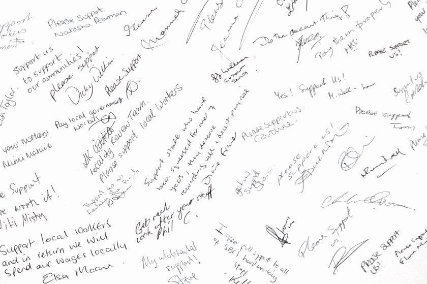 Image of supportive messages in Christmas card to local councillors demanding an end to Scrooge-like pay rises.