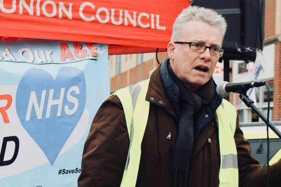 Photograph of Tim Sneller (Communications Officer, UNISON Southend-on-Sea) addressing Save Our NHS Southend supporters at rally at the top of the High Street, Southend-on-Sea.