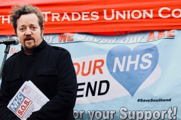 Photograph of campaigner addressing Save Our NHS Southend supporters at rally at the top of the High Street, Southend-on-Sea.