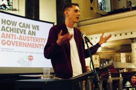 Photograph of Sam Fairbairn (National Secretary, The People's Assembly Against Austerity) addressing attendees at The People's Assembly Against Austerity CHANGE IS COMING conference.