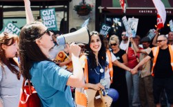 Photograph of Dr Aislinn Macklin-Doherty (Secretary, Health Campaigns Together) addressing protestors at the 'Our NHS is 70 Celebration & Demonstration' on Saturday 30th June.
