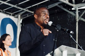 Photograph of Weyman Bennett (Joint National Convenor, Stand Up to Racism) addressing 'Our NHS is 70' rally at Westminster, London. (30 June 2018)