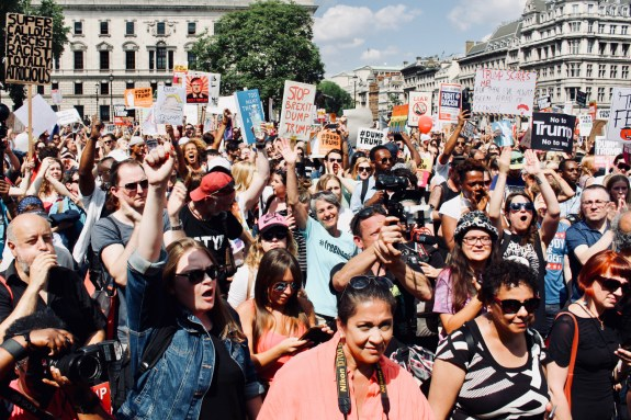 Photograph of protestors at BRING THE NOISE rally in Parliament Square, London.