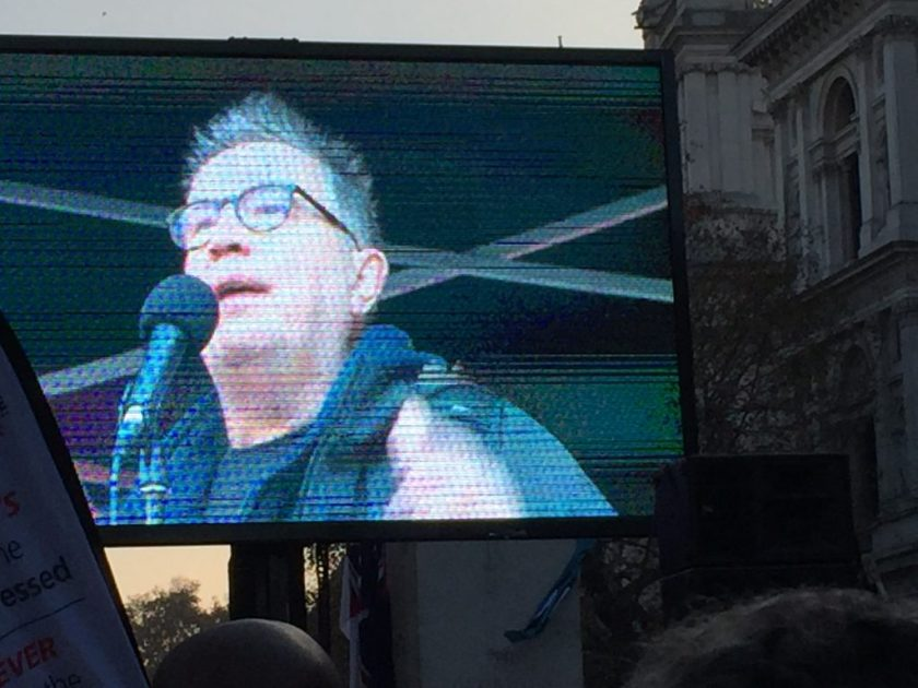 Photograph of Tom Robinson speaking at the rally outside Downing Street.