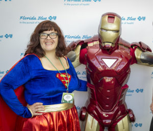 Melissa Elgersma celebrates with Florida Blue and their ReadingPals superheroes at the May 6, 2014 Appreciation Breakfast.