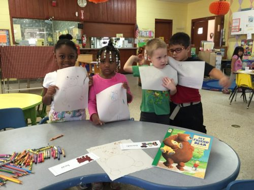 Students at Methodist Children's Village show off their learning activities from ReadingPals.