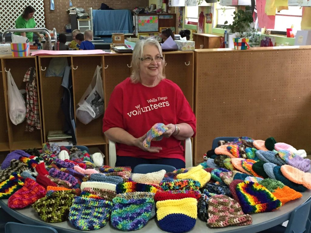 Pat Studer of Wells Fargo makes more than 200 crocheted hats each year. This year, she distributed them to students at a United Way Success By 6 Center.