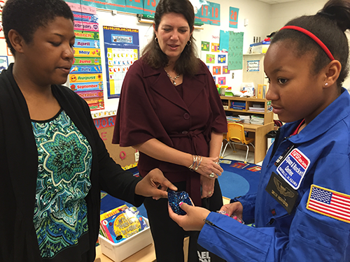 """Taylor Richardson, 11, and her mom, Latonja, show United Way of Northeast Florida President and CEO Michelle Braun the """"flubber"""" she learned to make at science camp."""