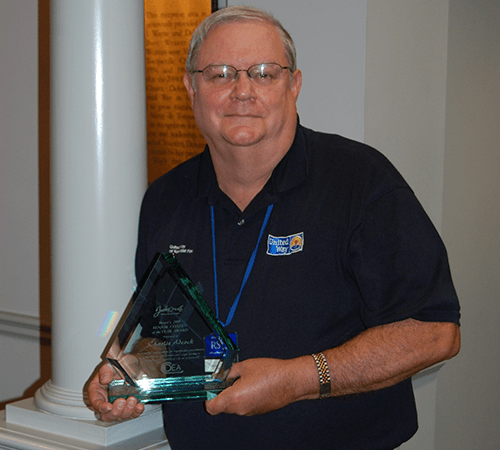 Charlie Adcock, pictured in the United Way offices in 2009 with his Mayor's Male Senior Citizen of the Year award for his contribution to improving the quality of life in Jacksonville.