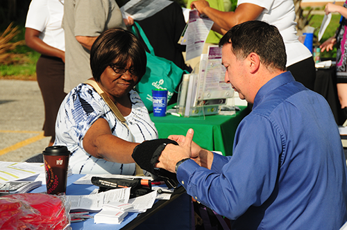 Your bank account isn't the only number to monitor regularly! Health screenings were available for seniors, including blood pressure checks.
