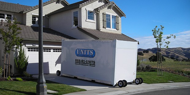 UNITS moving container in front of Emeryville home using it for portable storage