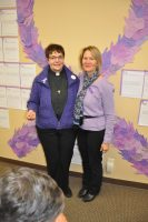 Rev. Dr. Anne Curtin and Ms. Kathryn Allen at an event for domestic violence awareness.