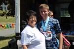 Martha Lasher-Warner congratulates a runner in The Run for Help
