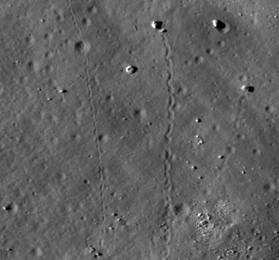 Closeup of LROC image showing boulders that have rolled down the slope of Tsiolkovskiy Crater.  Credit: NASA