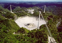 Image result for 1963 – The Arecibo Observatory in Arecibo, Puerto Rico, with the largest radio telescope ever constructed, officially opens