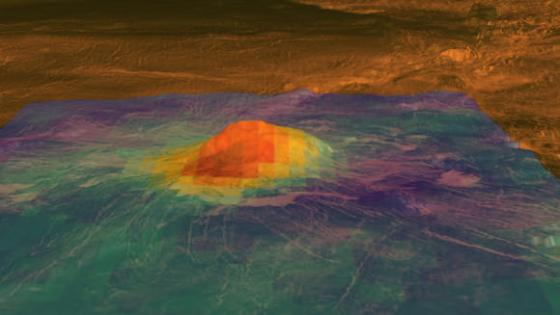 The colored overlay shows the emissivity derived from VIRTIS surface brightness data, acquired by ESA¹s Venus Express mission. The high emissivity area (shown in red and yellow) is centered on the summit and the bright flows that originate there. Image courtesy NASA/JPL-Caltech/ESA; image created by Ryan Ollerenshaw and Eric DeJong of the Solar System Visualization Group, JPL.