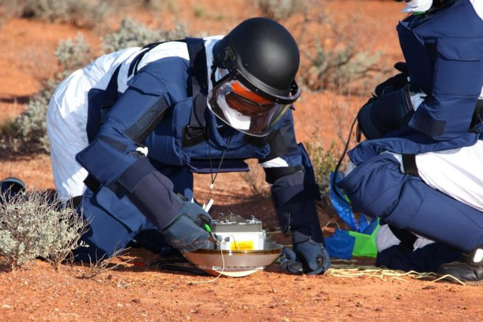 Recovery team makes sure all is safe with the sample return canister from the Hayabusa 1 Mission.