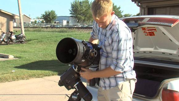 Levi Joraanstad, a student at North Dakota State University displays his telescope, which police mistook for a rifle. Image via WDAY TV, Fargo, North Dakota.