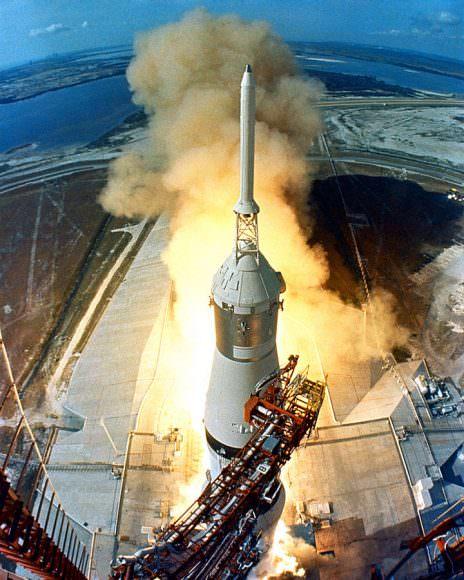 A Saturn IV launching the historic Apollo 11 mission. Image: NASA/Michael Vuijlsteke. Public Domain image.