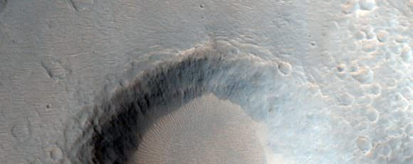 Crater Near Hydaspis Chaos. Credit: NASA/JPL/University of Arizona.