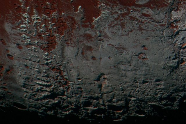 This area is south of Pluto's dark equatorial band informally named Cthulhu Regio, and southwest of the vast nitrogen ice plains informally named Sputnik Planitia. North is at the top; in the western portion of the image, a chain of bright mountains extends north into Cthulhu Regio. New Horizons compositional data indicate the bright snowcap material covering these mountains isn't water, but atmospheric methane that has condensed as frost onto these surfaces at high elevation. Credit: NASA/Johns Hopkins University Applied Physics Laboratory/Southwest Research Institute.