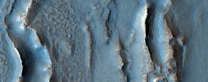 Deuteronilus Mensae (DM)has many rough surface features. The Mars Reconnaissance Orbiter has shown that many areas in DM are sub-surface glaciers covered by a thin layer of debris. Image: NASA/JPL/University of Arizona