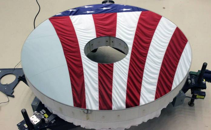 The Roman Space Telescope's primary mirror reflecting the American flag. Image Credit: L3Harris Technologies