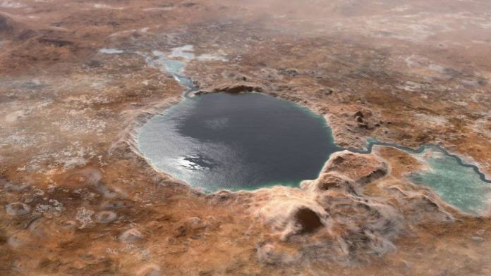 This illustration shows Jezero Crater — the landing site of the Mars 2020 Perseverance rover — as it may have looked billions of years ago on Mars when it was a lake. An inlet and outlet are also visible on either side of the lake. Image Credit: NASA/JPL-Caltech
