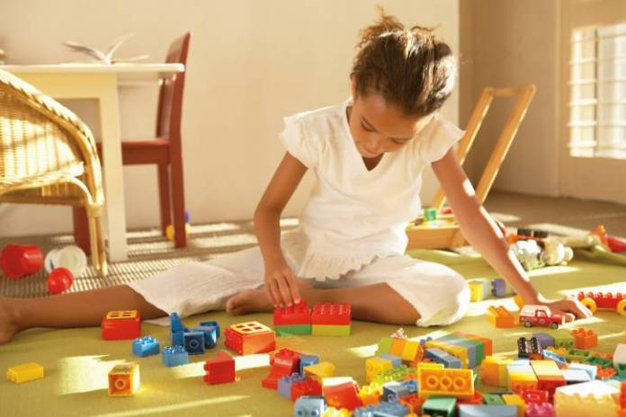 Girl Playing with Lego Blocks