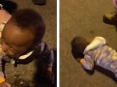 bambino che gattona in mezzo al traffico.