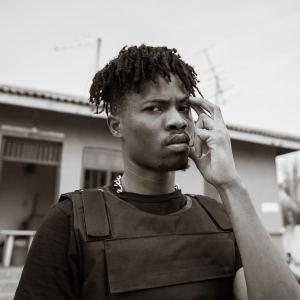 Kwesi Arthur In Bulletproof vest