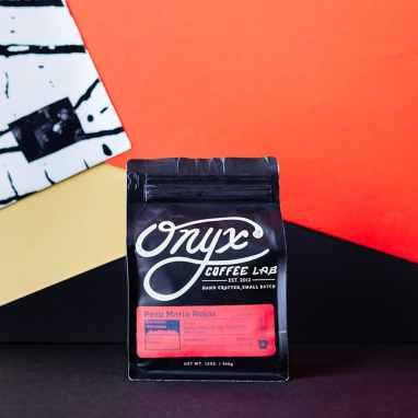 Onyx Coffee Lab Peru Maria Rojas coffee with album in the background