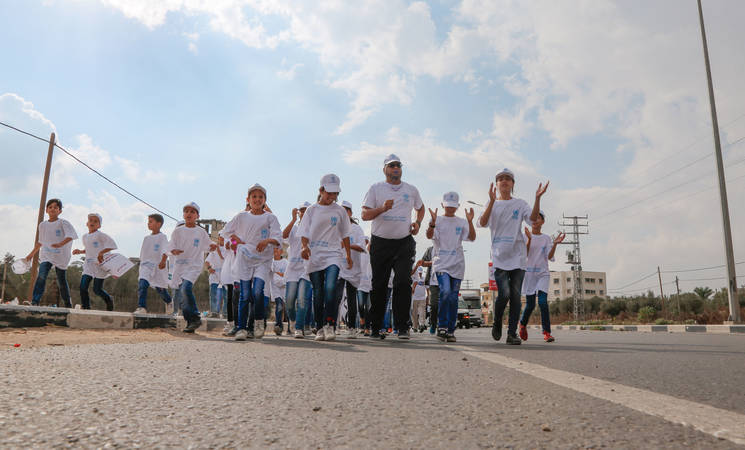 Students from UNRWA schools in Gaza participate in the 'Walking for Health' activity organized by UNRWA Community Mental Health Programme. © 2017 UNRWA Photo by Tamer Hamam