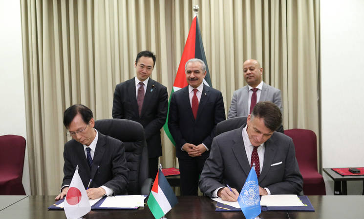 The Acting Commissioner-General of UNRWA, Christian Saunders (right), and Japanese Ambassador Magoshi (left) sign two contribution agreements amounting to some US$ 11.5 million in support of UNRWA in Ramallah in the presence of H.E. Dr Mohammed Shtayyeh, Prime Minister of the State of Palestine, and H.E. Mr. Keisuke Suzuki, State Minister of Foreign Affairs of Japan. (c) 2019 UNRWA Photo by Takuto Kubo.