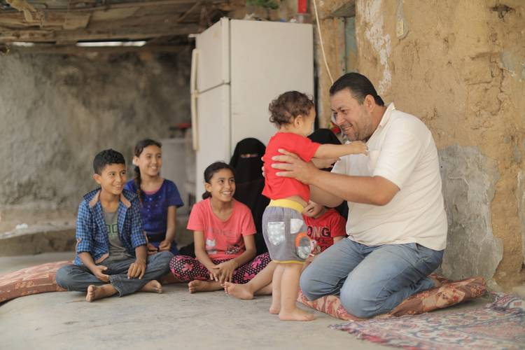 Ghassan Abu-Asser and his family in their rented home in Shejaiya, Eastern Gaza City. © 2018 UNRWA Photo by Mohammed Hinnawi