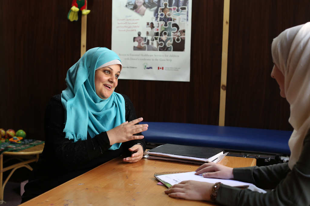 Ansam Al Hamamy (left) is a JCP beneficiary who works as physiotherapist in the Right of Life organization in Gaza. © 2016 UNRWA Photo by Tamer Hamam