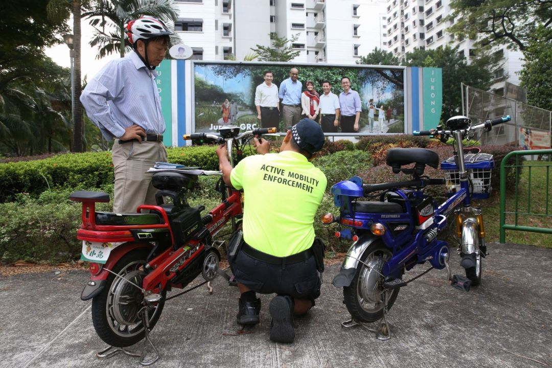 LTA officer checking power assisted mobility device for illegal modifications (via TODAYonline)