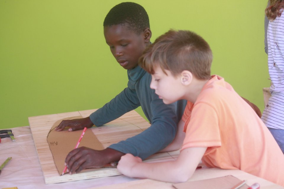 Two boys design a surfboard together