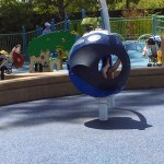Plays tructure at the Magical Bridge Playground in Palo Alto